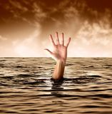 Drowning. A man drowning in the sea Stock Photo