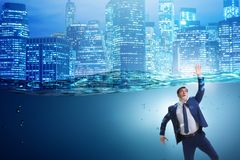 The drowning businessman in insolvency and bankruptcy concept. Drowning businessman in insolvency and bankruptcy concept Stock Photo