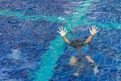 Free Drowning Child In Swimming Pool Asking For Help Royalty Free Stock Photo - 130148075