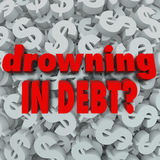 Drowning in Debt Words Dollar Sign Background Bankruptcy. The words Drowning in Debt on a dollar sign background to illustrate being poor, bankrupt, destitue Stock Image
