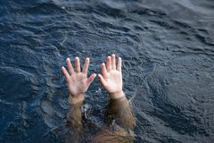 Drowning hands reaching Stock Images