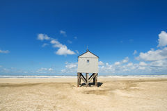 Drowning house at the beach Royalty Free Stock Image