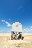 Drowning house at the beach Stock Images