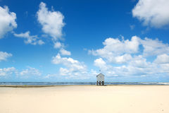 Drowning house at the beach Stock Photo
