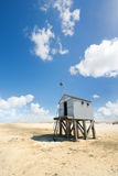 Drowning house at the beach Stock Image