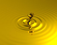 Drowning in liquid gold golden hand for help Royalty Free Stock Photography