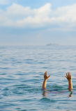 The drowning man. The man in water asks about the help Royalty Free Stock Photo