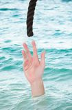 Drowning Man Reaching For Rope Royalty Free Stock Photography