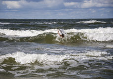 Drowning man in sea asking for help with raised his arms. Royalty Free Stock Photo