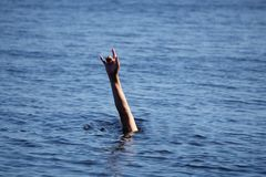 Drowning man Sticking hand out of water royalty free stock photos