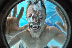 Drowning man underwater diver Royalty Free Stock Photo