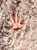 Drowning in sand Royalty Free Stock Photo