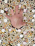 Drowning in a sea of pills Stock Photography