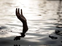 Drowning victims, Hand of drowning man needing help. Failure and Royalty Free Stock Photos