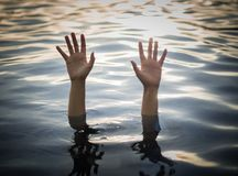 Drowning victims, Hand of drowning woman needing help. With selective focus.    Failure and rescue concept Royalty Free Stock Images