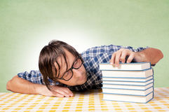 Drowsiness on books Stock Image