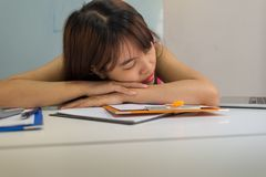 Drowsy girl falling asleep at office Royalty Free Stock Images