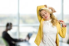 Drowsy girl on office window background. Stock Photo
