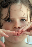 Drowsy little girl. A small girl just woke up from bed Royalty Free Stock Photos