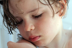 Drowsy little girl. A small girl just woke up from bed Royalty Free Stock Images