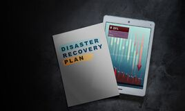 DRP Disaster Recovery Plan on Paper. Business Marketing Strategy Concept. Recession GDP Graph Information on Tablet Screen