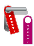 Dörrhängare med shhhh och pssst text Arkivfoton