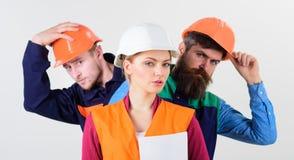 Drużyna architekci, budowniczowie, robotnicy, biały tło zdjęcie stock