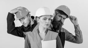Drużyna architekci, budowniczowie, robotnicy, odosobniony biały tło obrazy stock