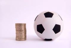 Druck-Kugel-und ein Pfund-Münzen Stockbild
