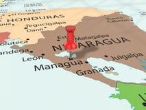 Druckbolzen auf Managua-Karte Stockfotografie