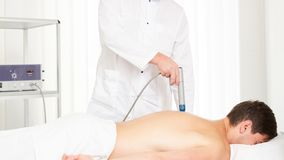 Druckwelletherapie Das Magnetfeld, Rehabilitation stockfotografie