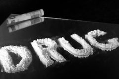 Drug. Word Written with Cocaine on a Mirror with 50 royalty free stock photography