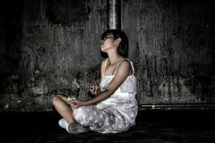 Drug abuse concept., overdose asian female drug addict use syringe injection narcotic to her hand., in scary abandoned. Building., In dark tone stock image