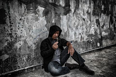 Drug abuse concept., Overdose asian male drug addict in action w. Ith drugs narcotic syringe in hand stock photos