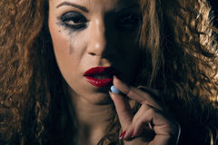 Drug abuse. Woman taking a pill. Royalty Free Stock Photography