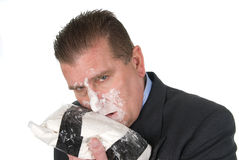 Drug addict businessman. A drug addict businessman snorts cocaine royalty free stock images