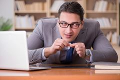 The drug addict businessman in the office Royalty Free Stock Photography