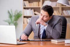 The drug addict businessman in the office Stock Images