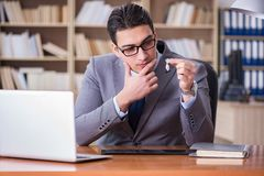 The drug addict businessman in the office Royalty Free Stock Images