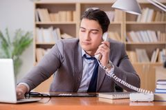 The drug addict businessman in the office Stock Photos