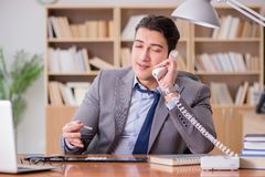 The drug addict businessman in the office Stock Image