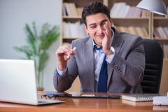 The drug addict businessman in the office Royalty Free Stock Photos