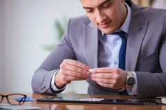 The drug addict businessman in the office Royalty Free Stock Image