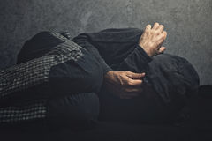 Drug Addict laying on the floor in agony stock photo