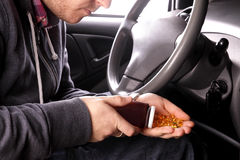 Drug addict man in the car Royalty Free Stock Photo