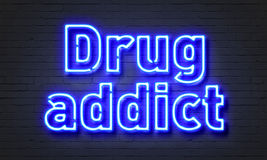 Drug addict neon sign Royalty Free Stock Image