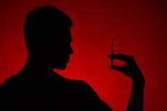 drug addict standing on red background Stock Images