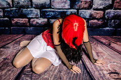 Drug addicted woman. Drug addict woman prostitute breaking down on the floor Stock Images