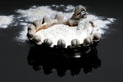 Drug addiction. White powder similar to cocaine in ashtray with skeleton Stock Image
