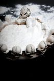 Drug addiction. White powder similar to cocaine in ashtray with skeleton Royalty Free Stock Photography